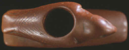 Top view of bird effigy pipe showing bowl and engraved feathers.